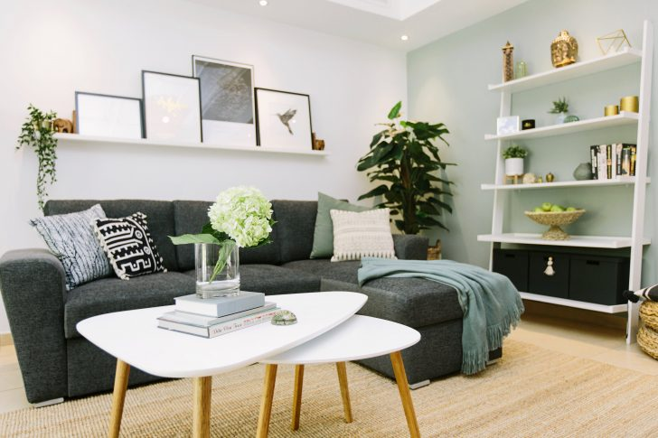 A living room with a couch and a table