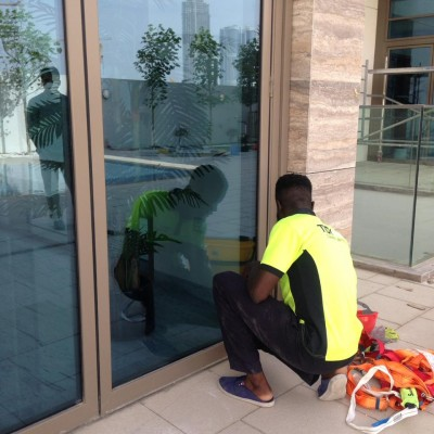 A person cleaning an external window