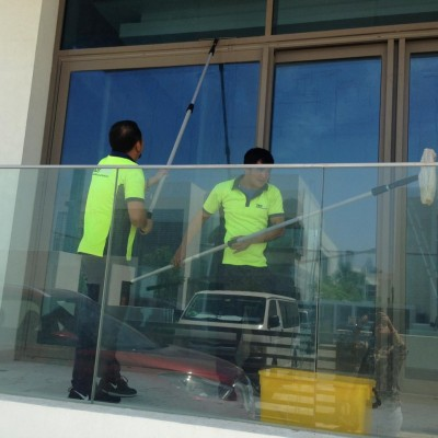 A group of people cleaning a balcony