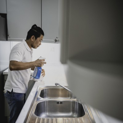 A man working on refurbishing a kitchen