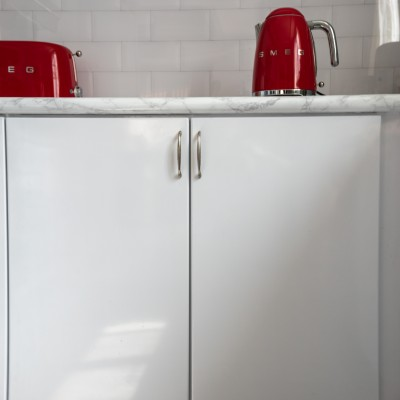 A red kettle in a kitchen