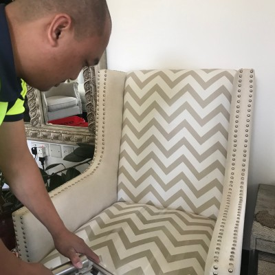 A man cleaning a chair