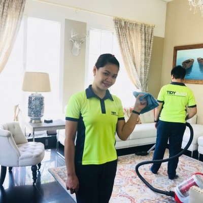 Tidy maids cleaning a room