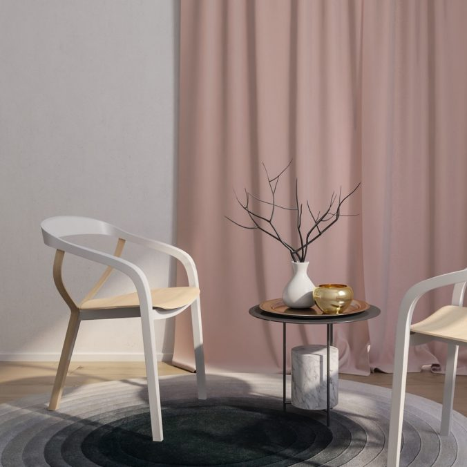 A chair sitting in front of a curtain