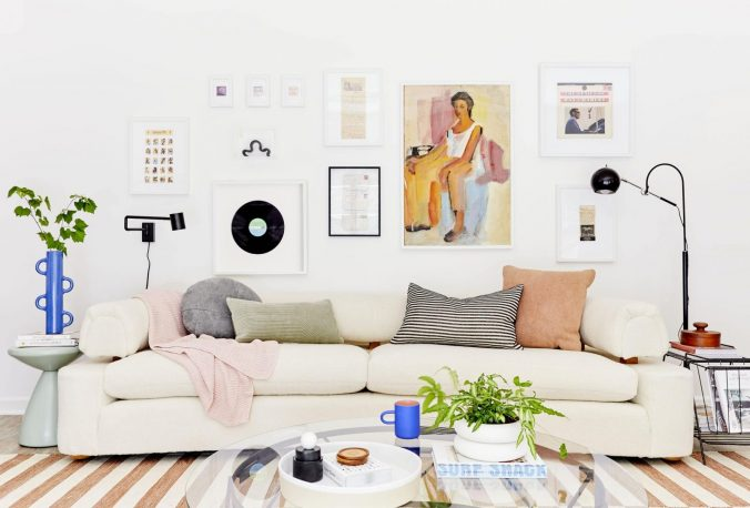 A living room filled with furniture and pictures on the wall