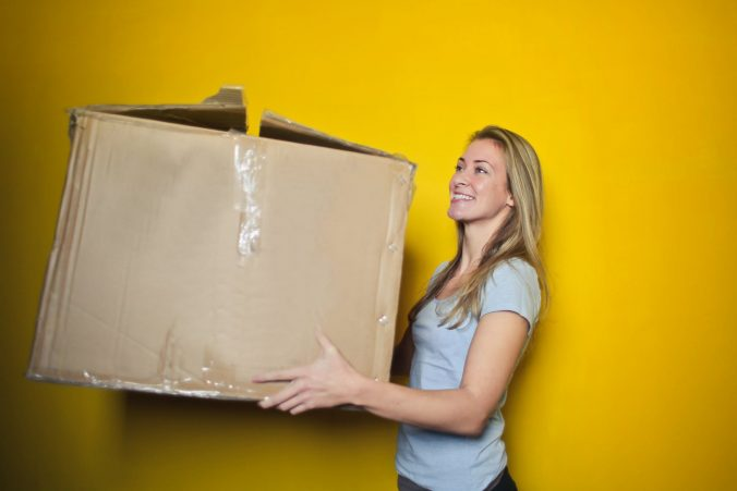 A person standing in front of a yellow wall
