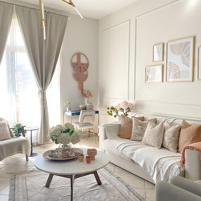 A living room filled with furniture and a large window by Vianne Khoury