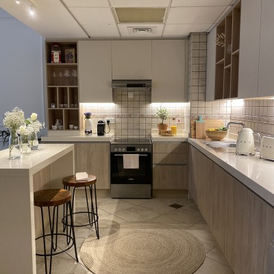A kitchen with a counter by Vianne Khoury