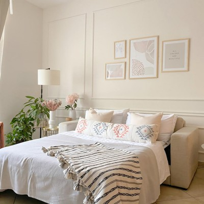 A bedroom with a large bed by Vianne Khoury