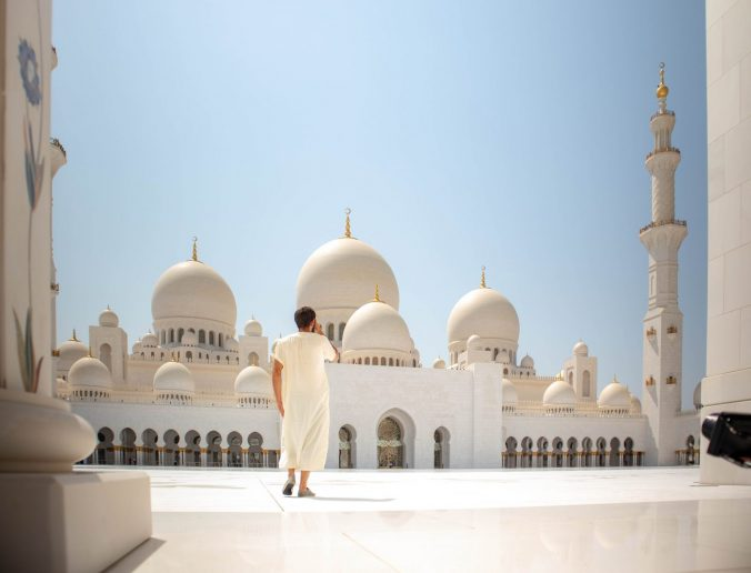 A large building with Sheikh Zayed Mosque in the background