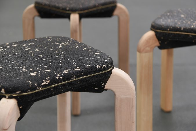 A stool in front of a wooden chair